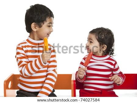 Siblings Enjoying Popsicles - stock photo