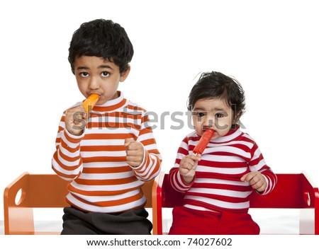 Siblings Enjoying Popsicles, Isolated, White - stock photo