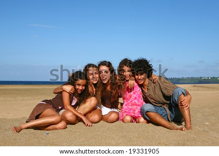 Siblings Enjoying Themselves on the Beach - stock photo