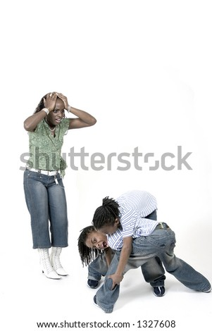 Siblings fighting while stressed mom watches - stock photo