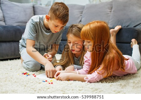 Siblings playing a game at home