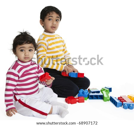 Siblings Playing with Blocks - stock photo