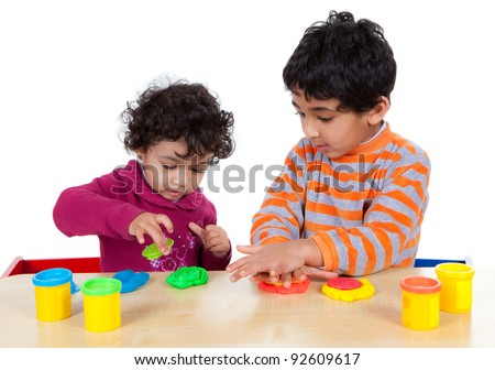 Siblings Playing with Play Dough, Isolated, White - stock photo