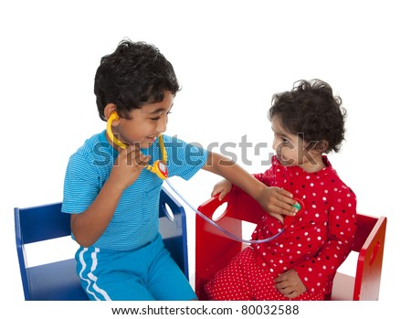 Siblings Posing as Doctor and Patient Indulging in Pretend Play, Isolated, White - stock photo