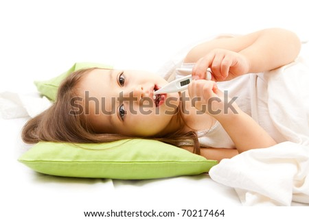 sic little girl on bed with - stock photo