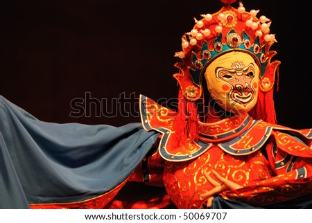 Sichuan opera is one of the Chinese oldest local operas??The face changing, or bianlian in Chinese, is an important intangible cultural heritage in China. - stock photo