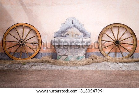 Sicilian cart wheels and fishing net - stock photo