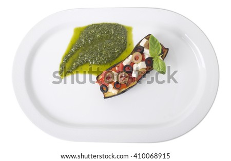 Sicilian style sicilian eggplant caponata with tofu and pesto sauce. Isolated on a white background. - stock photo