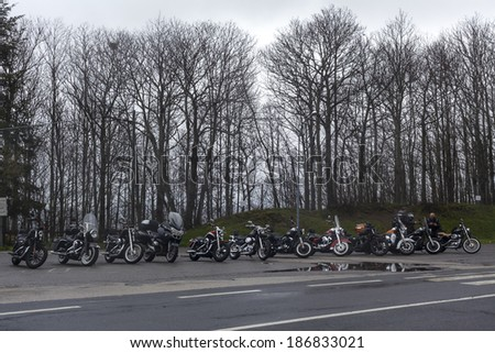 SICILY, ITALY - APRIL 5, 2014: Harley Davidson bikes belonging to the H.O.G. Malta Chapter parked against the treeline in Floresta, Sicily - stock photo
