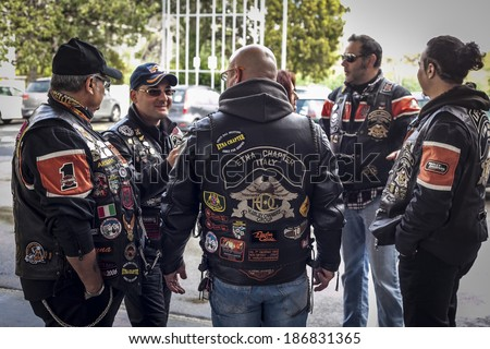 SICILY, ITALY - APRIL 6, 2014: Members of the H.O.G. Etna Chapter in Sicily. Harley Owners Group (H.O.G.) is made up of various local chapters from around the world. - stock photo