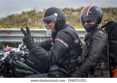 SICILY, ITALY - APRIL 4, 2014: Members of the H.O.G. Malta Chapter while on tour in Sicily. Harley Owners Group (H.O.G.) is made up of various local chapters from around the world. - stock photo
