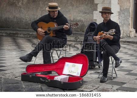 SICILY, ITALY - APRIL 5, 2014: Two Italian buskers play Italian music in Taormina in Sicily - stock photo
