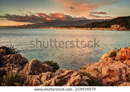 Sicily, Italy: Etna seen from Taormina at sunrise - stock photo