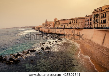 Sicily, Italy: Mediterranean coast of Syracuse in the sunset - stock photo