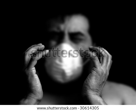 Sick and frightened man covering his mouth and nose with a surgical mask - stock photo
