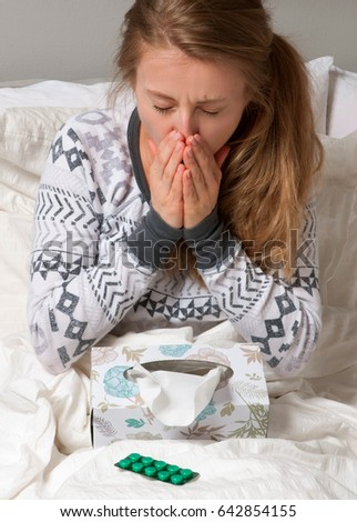 Sick and Virus. Woman has cold, flu and high fever.
