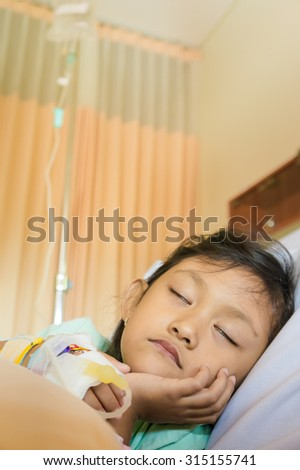 Sick Asian Ethnic Little Girl Patient Sleeping in Hospital Room - stock photo