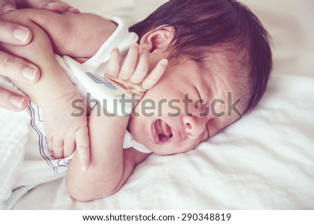 Sick baby, Soft focus and blurry, retro filter effect - stock photo