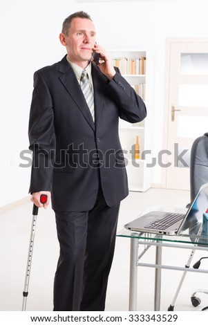 Sick businessman at work - stock photo