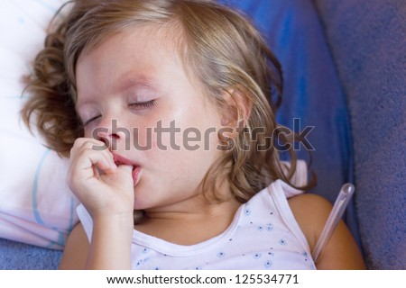 sick child crying while he measures the temperature and finger sucking,best focus on the face, soft focus