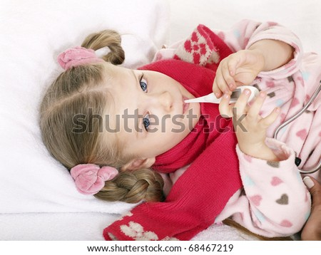 Sick child in bed recovers. Isolated on white. - stock photo