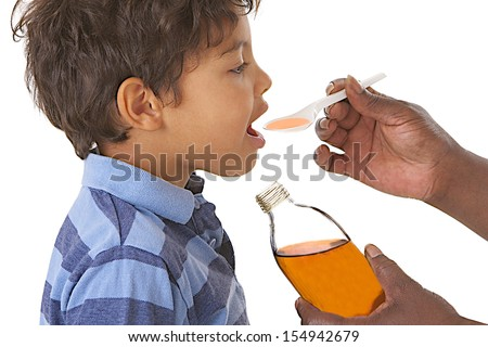 Sick child taking syrup against cough or flu - stock photo