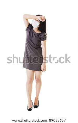 Sick Chinese woman wearing a face mask about to faint. - stock photo
