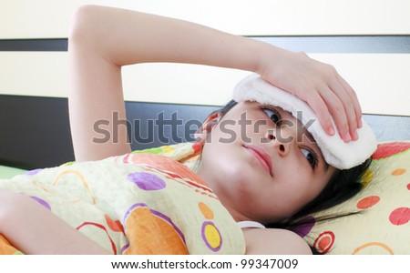 Sick girl in bed - stock photo