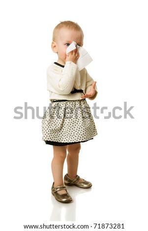 Sick girl sneezing standing isolated on white - stock photo