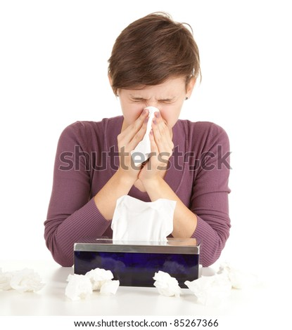 sick girl with flu blowing her nose, series - stock photo