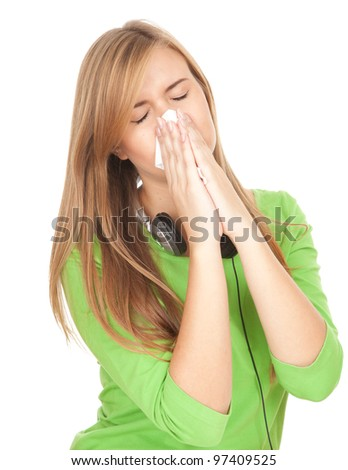 sick girl with flu blowing her nose, white background