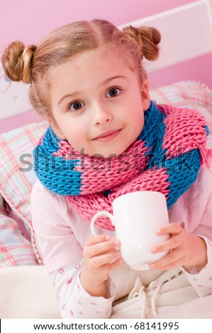 Sick girl with hot tea in bed - stock photo