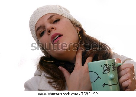 Sick In Winter A young woman is holding a cup of tea. She is sick and in pain with winter gear on. Isolated over white with space for text. - stock photo