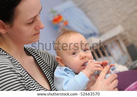 Sick infant inhaling medicine - stock photo