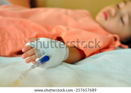 Sick kid sleeping in hospital  - stock photo
