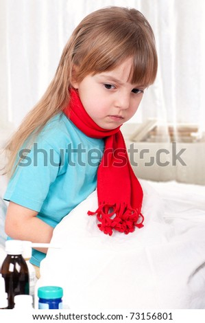Sick little beautiful girl with red scarf in the bed - stock photo