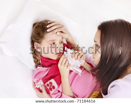 Sick little girl with mother. Isolated. - stock photo