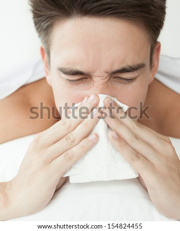 Sick man. Flu. Man caught cold. Virus. - stock photo