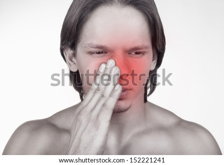 Sick man having trouble with sinus pain isolated on white background - stock photo