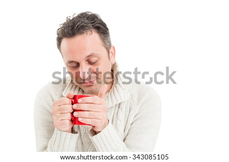 Sick man on winter flu concept isolated on white background