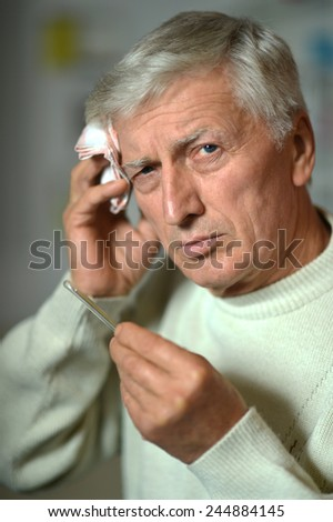 Sick old man on grey background background