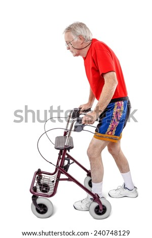 Sick old man walking with a walker - stock photo