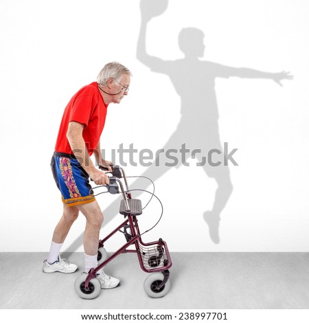 Sick old man walking with a walker along with a shadow of a young athlete on the wall. Concept for youth passing like a shadow or hope for health rehabilitation or recovery motivation. - stock photo