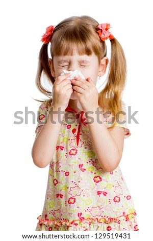 sick or crying child wiping or cleaning nose with tissue isolated - stock photo