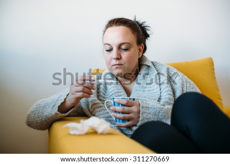 Sick Overweight woman measuring temperature - stock photo