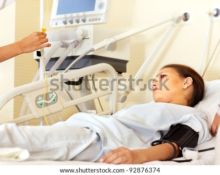 Sick patient on gurney in operating room. - stock photo