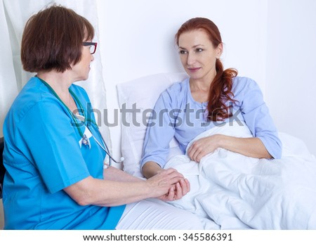 sick patient talking to a nurse in the hospital - stock photo