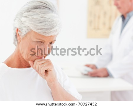 Sick patient with her doctor