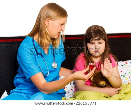 Sick Schoolgirl refusing the treatment offered by her pediatrician. - stock photo