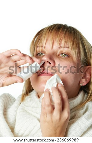 Sick with a rhinitis woman dripping nose medicine isolated on white - stock photo